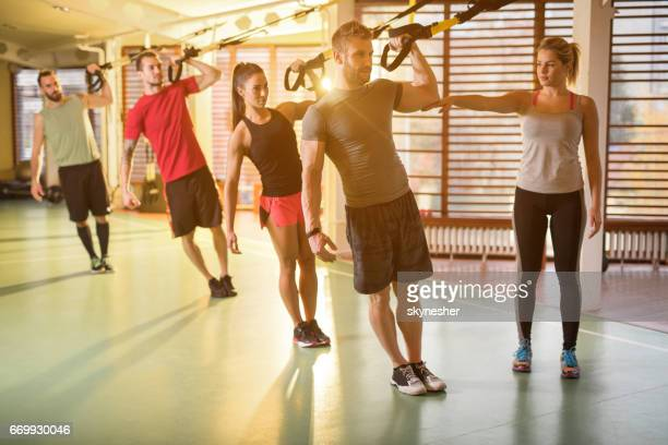 athletic people having a cross training in a health club. - circuit training stock photos and pictures