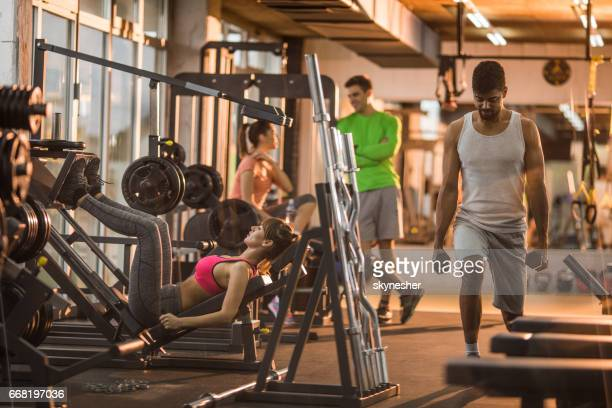 Athletic people working out in a health club.