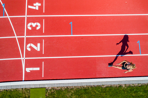 Athletic sports, female sprinter, finish from above - gettyimageskorea