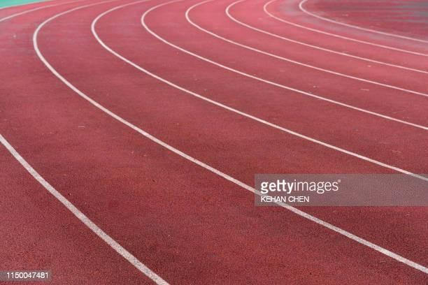athletic track empty track and field stadium - sprint sport wettbewerbsform stock-fotos und bilder