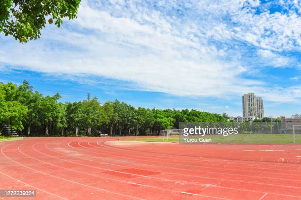 athletic track in the playground of the school. - all weather running track stock pictures, royalty-free photos & images