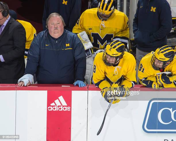 Athletic Trainer Rick Bancroft of the Michigan Wolverines works the door during the Duel in the D game against the Michigan State Spartans at Little...