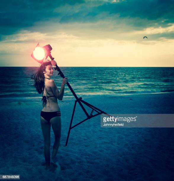 athletic woman at the beach sunset - gel effect lighting stock photos and pictures
