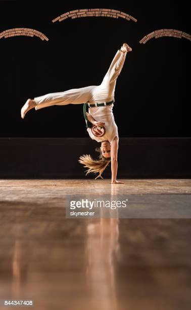 capoeira female athlete doing handstand sports