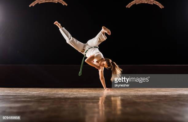 athletic woman exercising handstand on capoeira training in a health club. - capoeira imagens e fotografias de stock