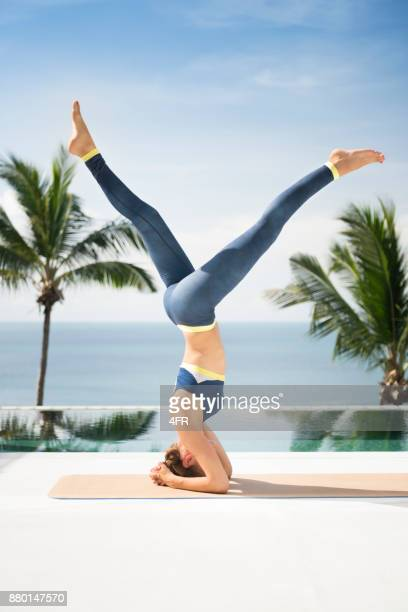 athletic woman in a yoga headstand - legs apart stock photos and pictures