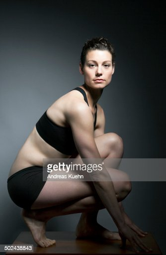 Black Label Price >> Athletic Woman Kneeling Down Portrait Stock Photo | Getty Images