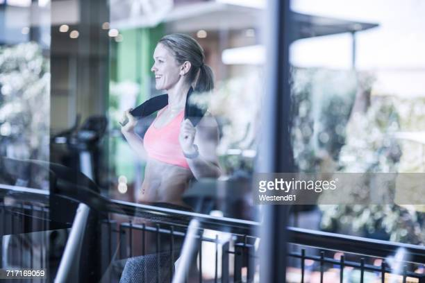 Athletic woman on treadmill at the gym
