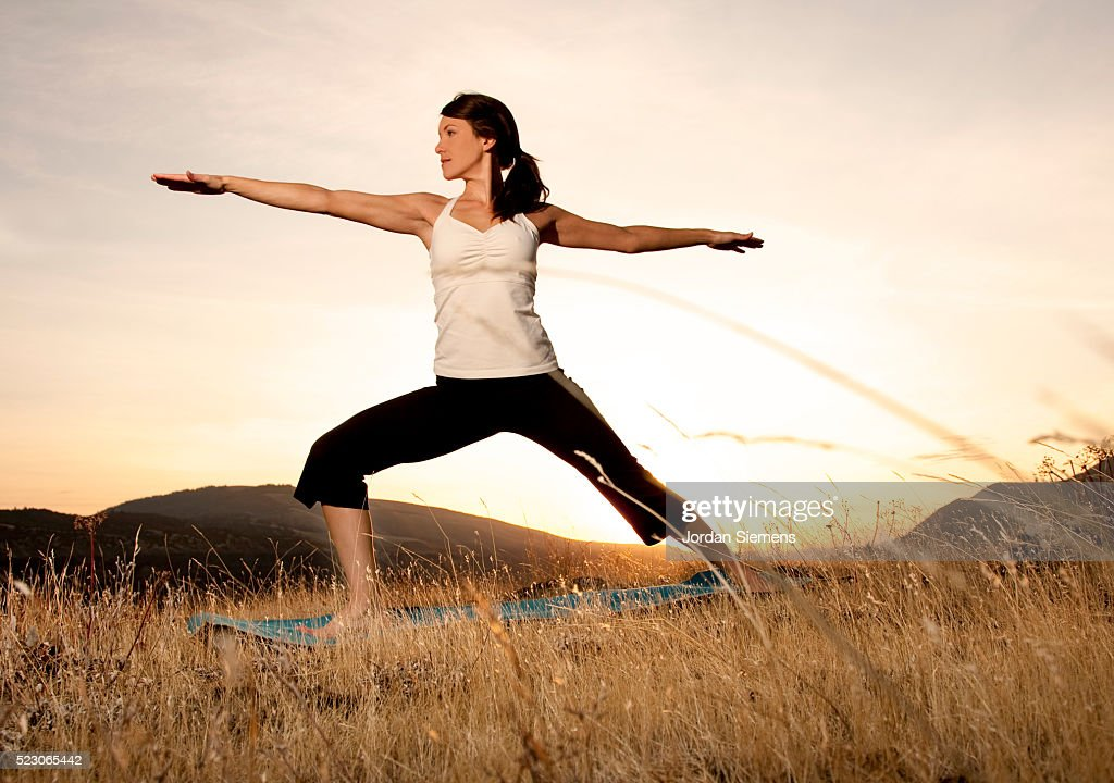 Athletic woman practicing yoga : Stock Photo