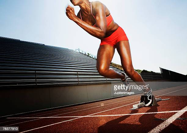 Athletic woman running a race