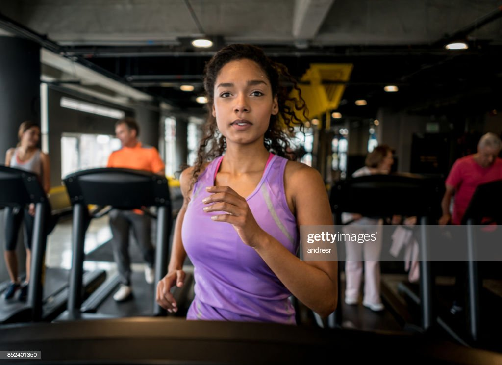 Athletic woman running at the gym : Stock Photo