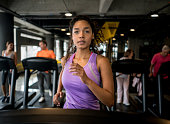 Athletic woman running at the gym