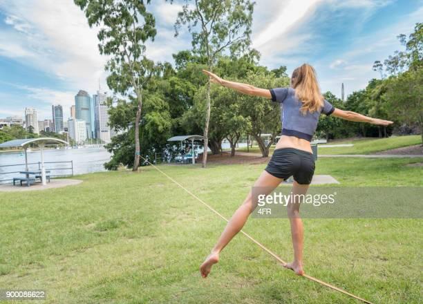 Athletic woman Slacklining, Brisbane, Australia