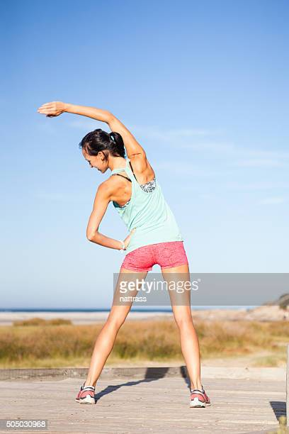 Athletic woman stretches after her run
