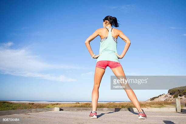Athletic woman stretches before she runs