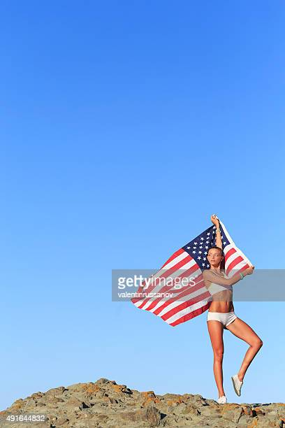 athletic woman with american flag - hawaii flag stock pictures, royalty-free photos & images