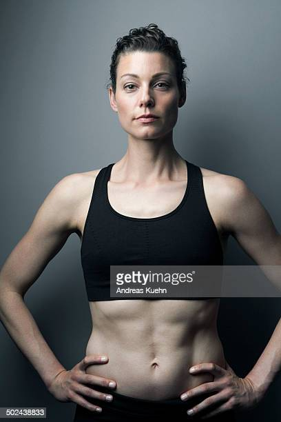 Athletic woman with strong abs, portrait.