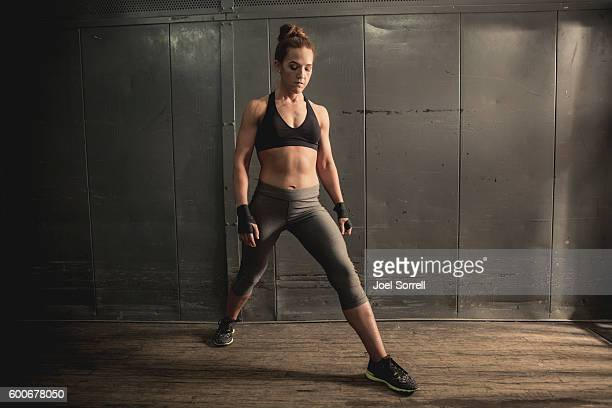 Athletic Woman Working Out and Doing Lunges