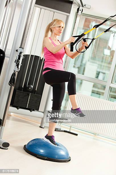 athletic young woman having a sports training in a gym. - strap stock pictures, royalty-free photos & images