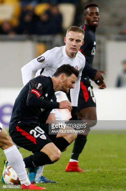 Athletico Bilbao's Aritz Aduriz reacts after a tackle from Zorya's Oleksandr Svatok during the UEFA Europa League Group J football match between...