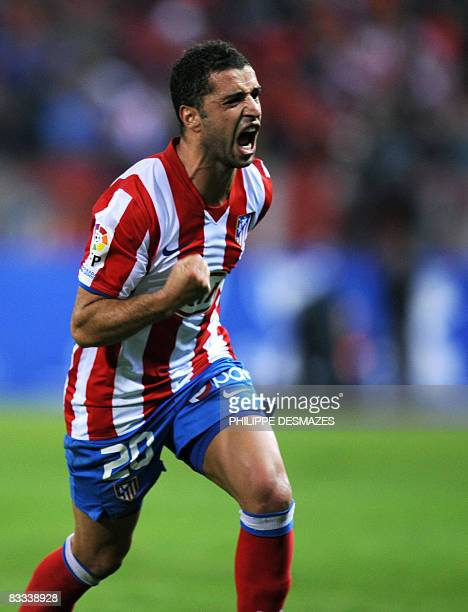 Athletico Madrid's Portuguese Simao celebrates after scoring against Real Madrid during a Spanish league football match at the Vicente Calderon...