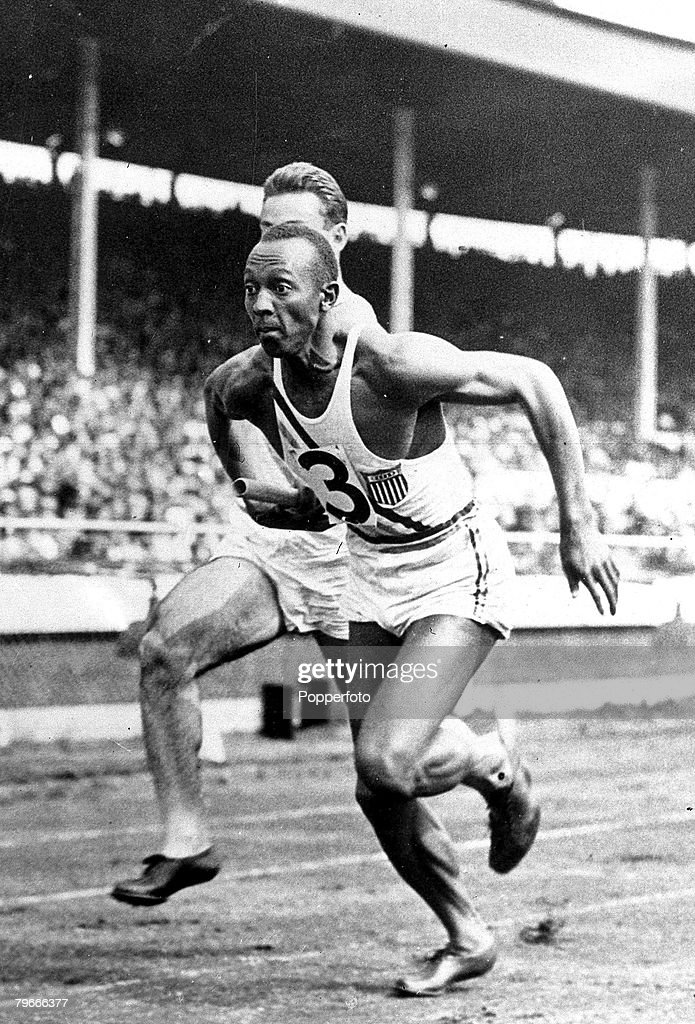 Athletics, 15th August 1936, U,S,A,'s Jessie Owens taking over the baton from M,O,Glickman during the 4x 100 yard relay race here
