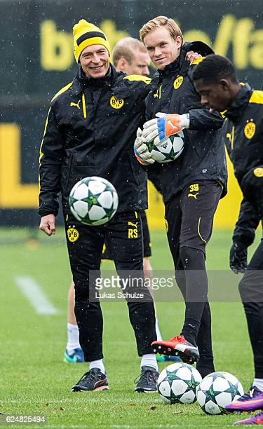 Athletics coach Rainer Schrey and Goalkeeper Hendrik Bonmann stay together during a training session ahead of their Champions League match against...