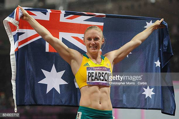 Australian Sally Pearson celebrates her gold medal winning finish in the 100 meter hurdles at track and field at the Olympic Stadium during the 2012...