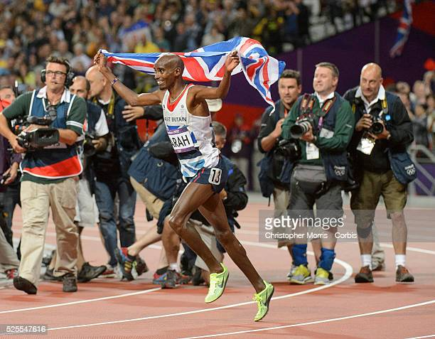 Athletics- Day 8 Great Britain's Mo Farah celebrates after winning the men's 10,000 meter race at the Olympic Stadium, during the 2012 London Olympic...
