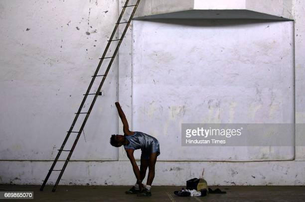 Athletics Disabled Athletes Komalchand Lalaji Barewar of Gondhia a loner by nature stretches before his 100m race Barewar lost his hand in 1998 while...