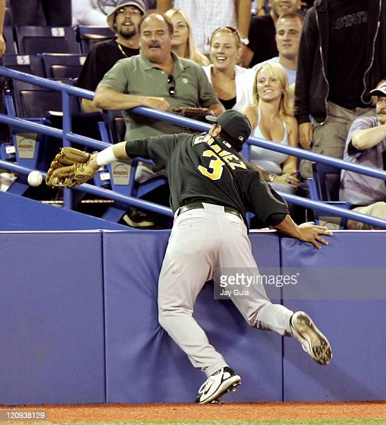 Athletics' Eric Chavez reaches into the camera box but just misses a foul popup in Oakland's 42 loss to the Toronto Blue Jays at Rogers Centre in...