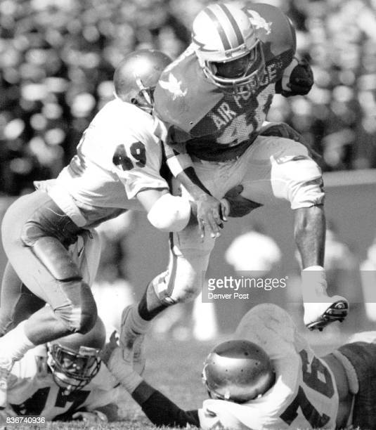 S A F A Athletics Football HB Greg Johnson powers his way up the middle as Navy's Bart B LaRocca bangs on AFA won the game 3424 Credit The Denver Post