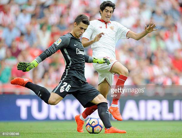 Athletic's goalkeeper Kepa Arrizabalaga vies with Sevilla's forward Carlos Fernandez during the Spanish league football match Athletic Club Bilbao vs...