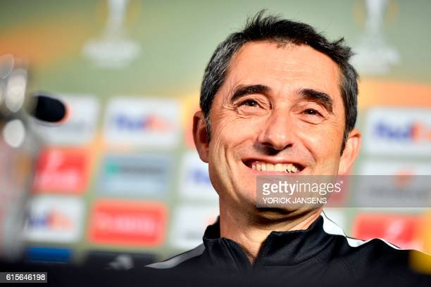 Athletic's head coach Spanish Ernesto Valverde smiles as he takes part in a press conference on October 19 in Genk on the eve of the e Europa League...