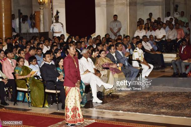 Athletics Hima Das before receiving Arjuna Award 2018 for his achievements in Athletics from President Ramnath Kovind during the National Sports and...