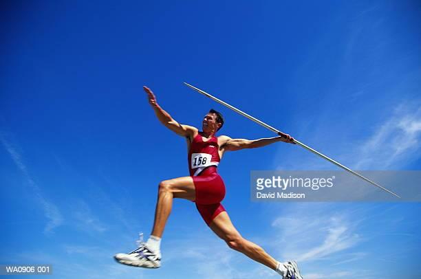 athletics, javelin competitor in action, low angle view - sportsperson stock-fotos und bilder