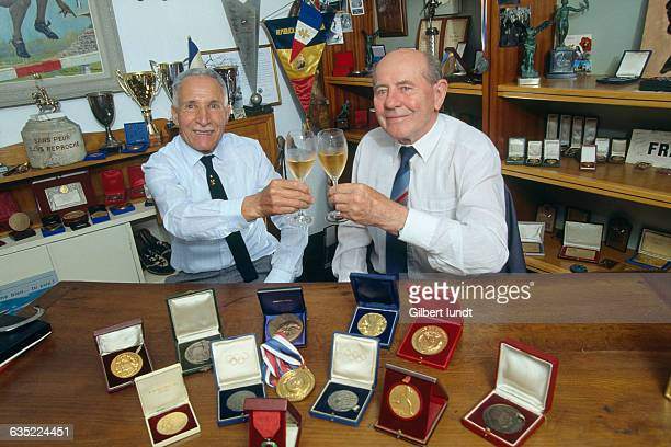 Athletics legends Alain Mimoun and Emil Zatopek drinking champagne in Mimoun's house Zatopek and Mimoun while rivals were great friends They competed...