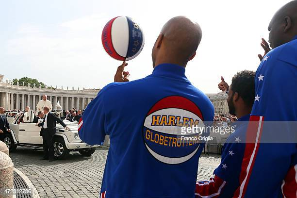Athletics of Harlem Globetrotters wave to Pope Francis as he arrives in St Peter's Square for his weekly general audience on May 6 2015 in Vatican...