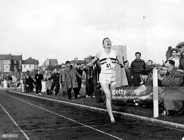 Athletics Oxfordshire England 6th May Roger Bannister breaks the tape as he crosses the winning line to complete the historic four minute mile record