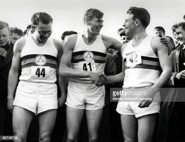Athletics Oxfordshire England 6th May Roger Bannister shakes hands with Chris Brasher and Chris Chataway after he completed the historic four minute...