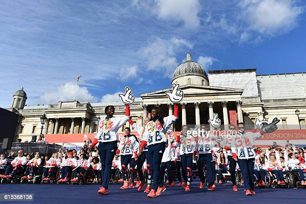 Athletics team great the spectators during the Olympics Paralympics Team GB Rio 2016 Victory Parade at Trafalgar Square on October 18 2016 in London...