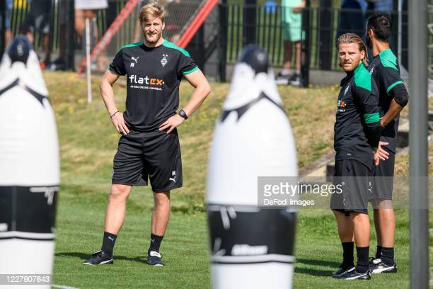 Athletikhead coach Markus Mueller of Borussia Moenchengladbach and Talentmanager Eugen Polanski of Borussia Moenchengladbach look on during the first...