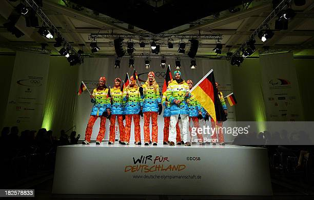 Athlets are seen on the catwalk during the German Olympic and Paralympic team kit presentation at Messe Duesseldorf on October 1 2013 in Dusseldorf...
