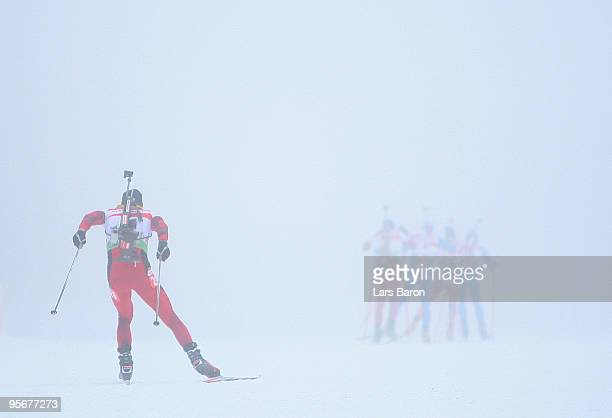 Athlets compete in the fog during the Men's 15 km mass start in the eon Ruhrgas IBU Biathlon World Cup on January 10 2010 in Oberhof Germany