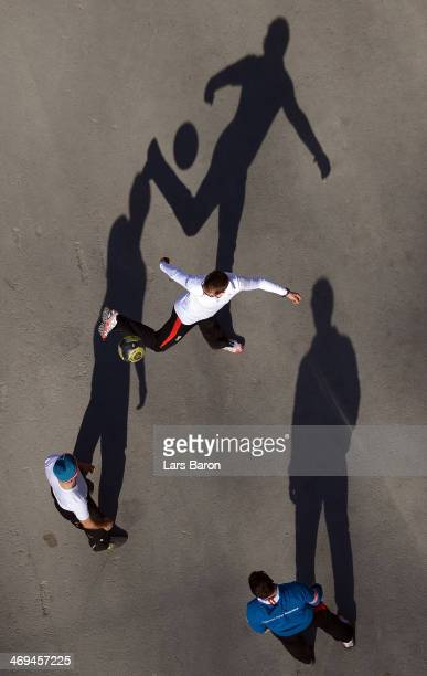 Athlets of Austria warm up while playing football during the Men's Individual Gundersen Large Hill/10 km Nordic Combined training on day 8 of the...