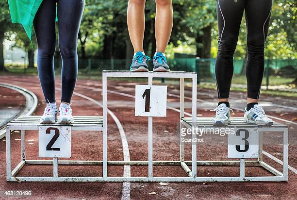 athlets on podium - bronze medalist stock pictures, royalty-free photos & images