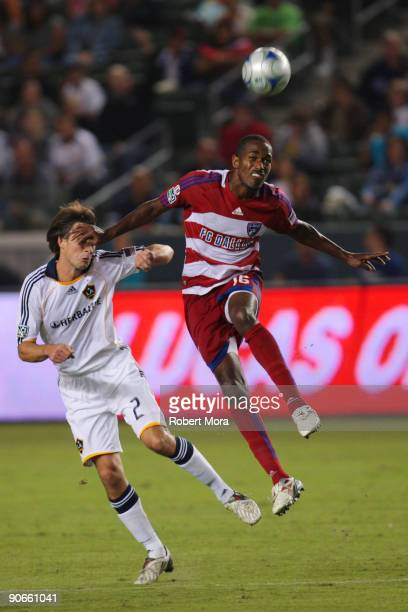 Atiba Harris of FC Dallas heads a loose ball over Todd Dunivant of the Los Angeles Galaxy during their MLS game at The Home Depot Center on September...