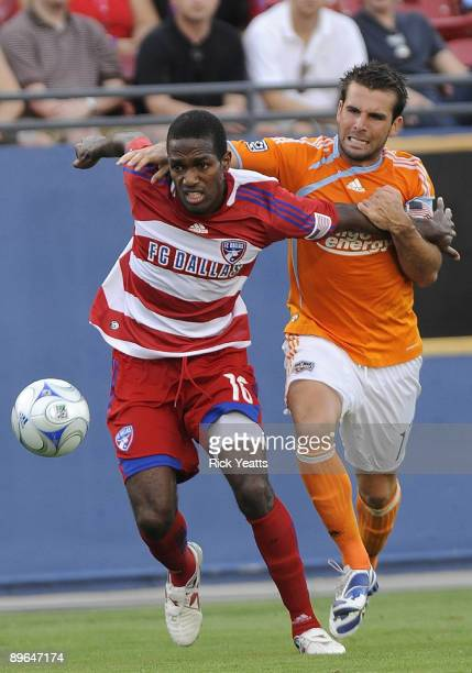 Atiba Harris of the FC Dallas runs the ball away from Mike Chabala of the Houston Dynamo at Pizza Hut Park August 6, 2009 in Frisco, Texas.
