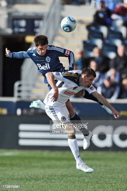 Atiba Harris of the Vancouver Whitecaps heads the ball over the top of Sebastien Le Toux of the Philadelphia Union at PPL Park on March 26 2011 in...