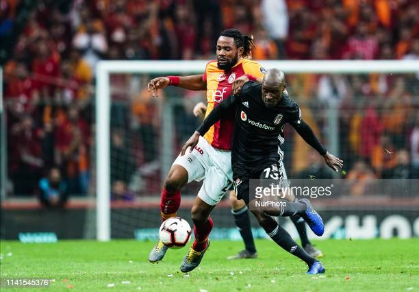 Atiba Hutchinson of Besiktas and Semih Kaya of Galatasaray challenging for the ball during the Turkish Super Lig match between Galatasaray SK and...